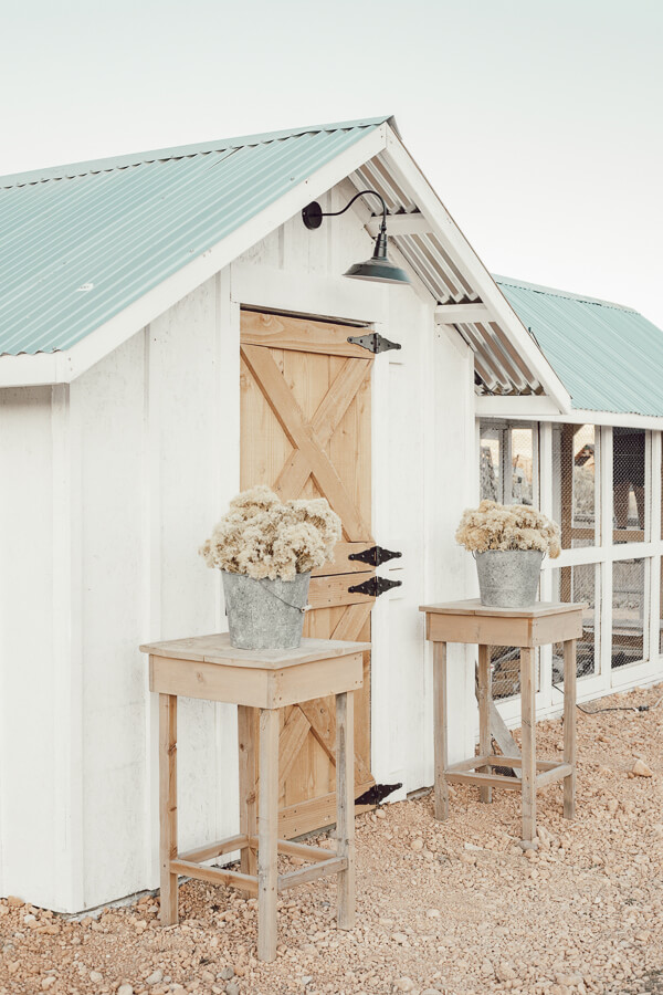 What a gorgeous chicken coop design! I love the dutch door, solar lights, and outdoor chicken run with a tin roof. Its so pretty!