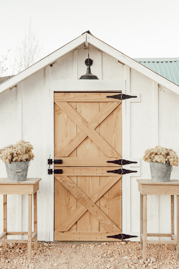 This chicken coop design is beautiful and functional!  Love this dutch door and and you believe that light is solar charged?  Gorgeous!