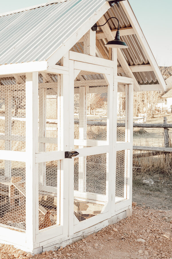Gorgeous chicken coop design ideas, complete with tin roof, board and batten, a dutch door and stylish outdoor solar lights!