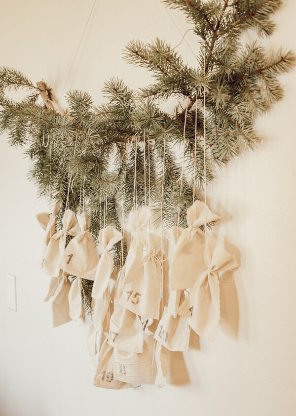 Cute Scandinavian inspired advent calendar with muslin bags and a tree branch!