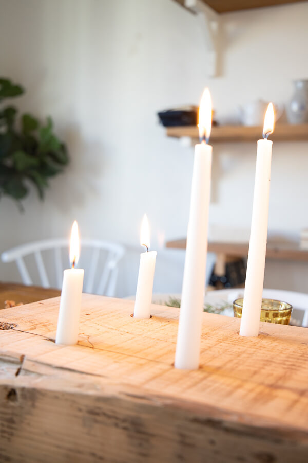 Under the glow of a cluster of candles this Thanksgiving tablescape is truly cozy and inviting!