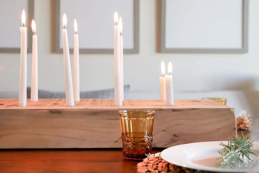 Make this easy DIY wood candle holder and create an amazing table centerpiece, put it on your fireplace mantel for a gorgeous focal point or add this rustic candle holder to a coffee table for instant ambiance.