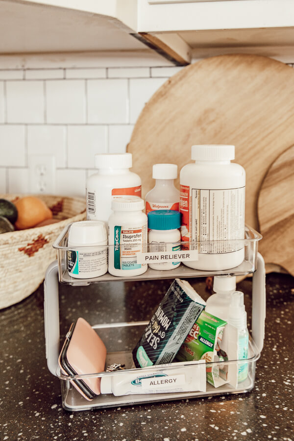Organization tips for the perfectly arranged medicine cabinet! Ours is in a lazy susan cabinet and its so hard to keep it clean! Come see what we do to keep it organized!