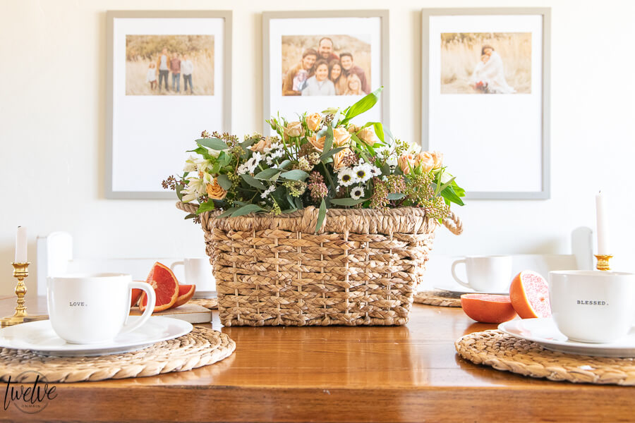 Basket full of spring flowers is the perfect spring table centerpiece! Love using fresh flower arrangements in my home!