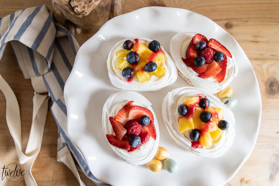 Simple and easy mini pavlova recipe! These are so easy to make and taste amazing! make them for your next get together or as a special weeknight treat!! I promise you can make them!