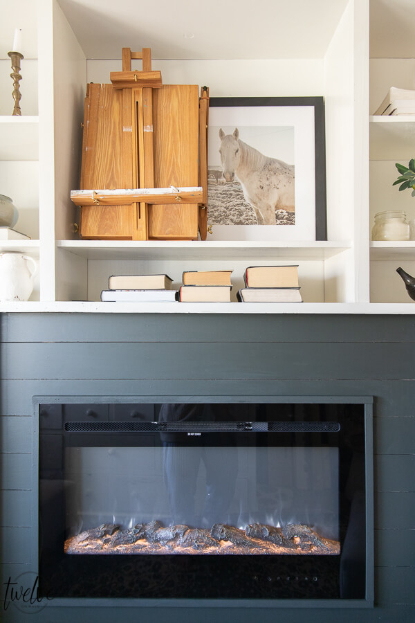 How I used my Wagner paint sprayer to makeover my office bookshelves and how we added a built in electric fireplace to the space in only a couple hours on a Saturday!