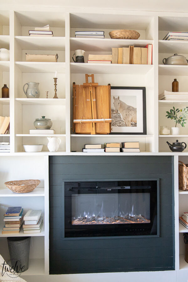 How I used my Wagner paint sprayer to makeover my new bookcases and how we added a built in electric fireplace to the space in only a couple hours on a Saturday!