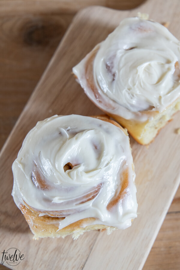 How to make the most delicious light and fluffy cinnamon rolls. These are amazing, soft, and topped with the most amazing tangy cream cheese frosting.