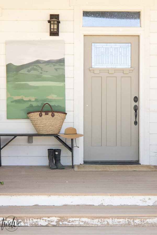How to use artwork in your front porch decor! Get tons of front porch decor tips and ideas. Decorating does not have to be expensive or complicated!