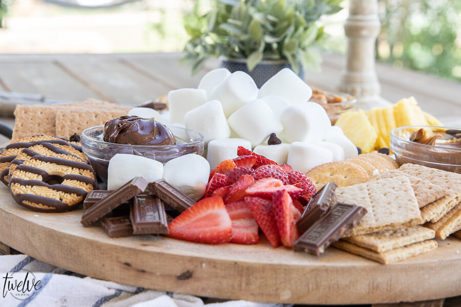 How to create a super simple and fun s'mores bar that's perfect for a night our with family.  I love to add marshmallows, fruits, crackers and cookies as well as peanut butter, Nutella and more!