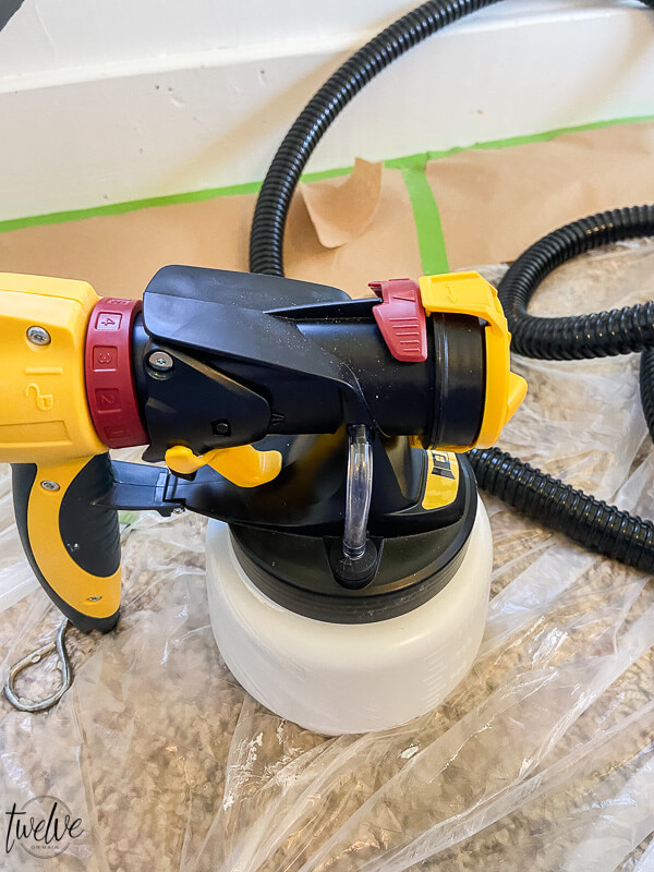 How to paint a room using a paint sprayer. Check out the step by step instructions, showing how easy it is to get this done in an afternoon. We used the Wagner Spray Tech Flexio 4300 paint sprayer and it did an amazing job.