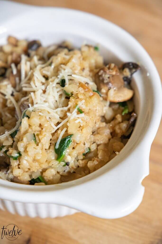 Make the most amazing cauliflower rice recipe! This cauliflower rice risotto is easy to make, packed with flavor and is so good for you!