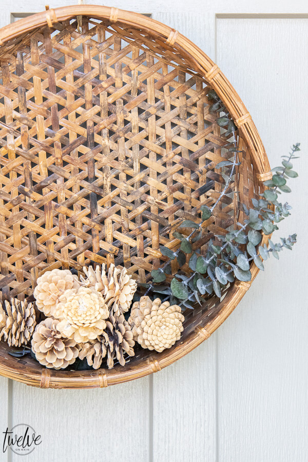 A gorgeous pine cone and eucalyptus fall wreath DIY that is easy to make affordable, and has a classic style that will last.