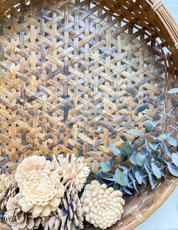 How to make a fall wreath with simple earthy elements such as eucalyptus, pine cones and baskets.