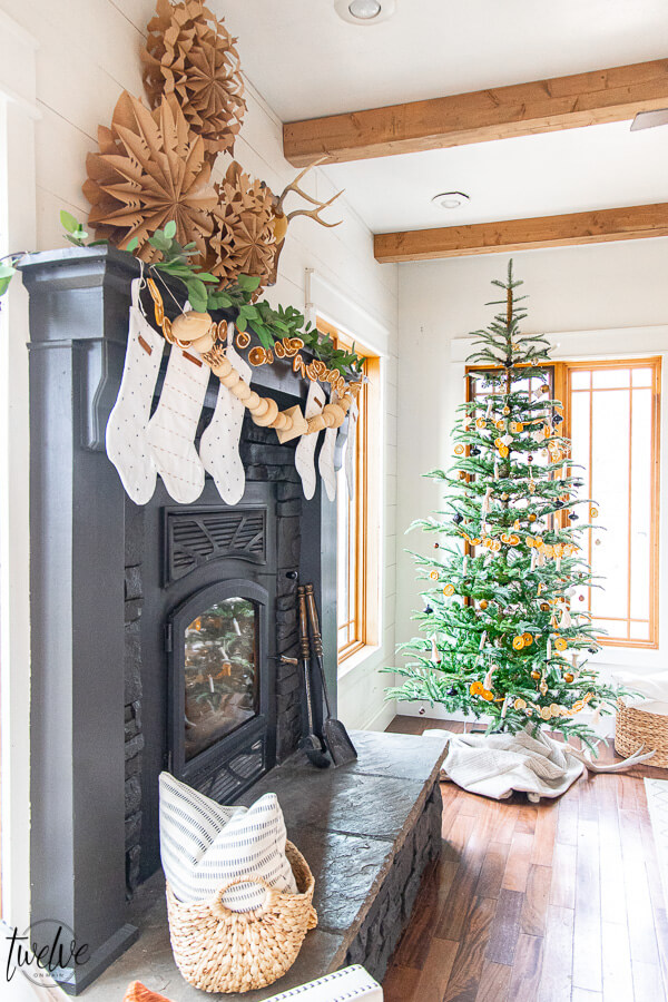 How to paint a stone fireplace with a paint sprayer and give it an updated and modern look in no time! See how I gave my stacked stone fireplace a complete facelift with just a coat of paint.