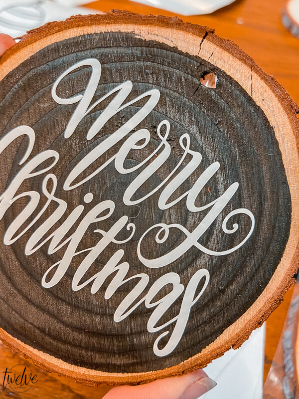 These handmade Christmas ornaments are the perfect gift to give to family and friends! Make them easily with wood rounds and cut the designs on the Cricut Maker. Don't have one? Let me tell you why you should get one!