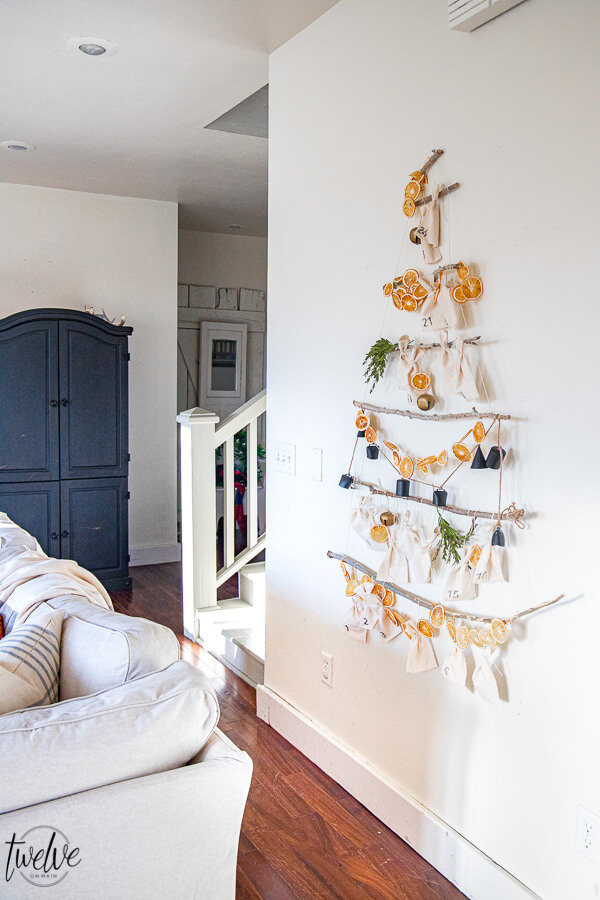 Gorgeous Scandinavian inspired Christmas tree advent calendar.  This is a fun way to involve your kids and use it as a focal point of your homes Christmas decor.