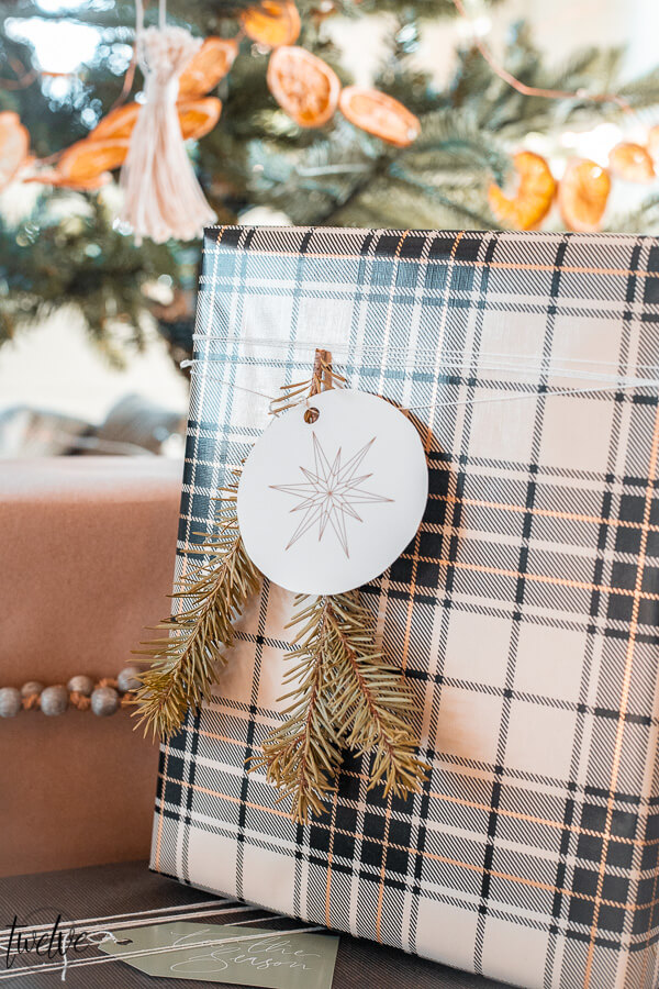 Holiday gift wrapping ideas using craft paper, combining patterns, using unusual items as accents, and FREE printable gift tags!