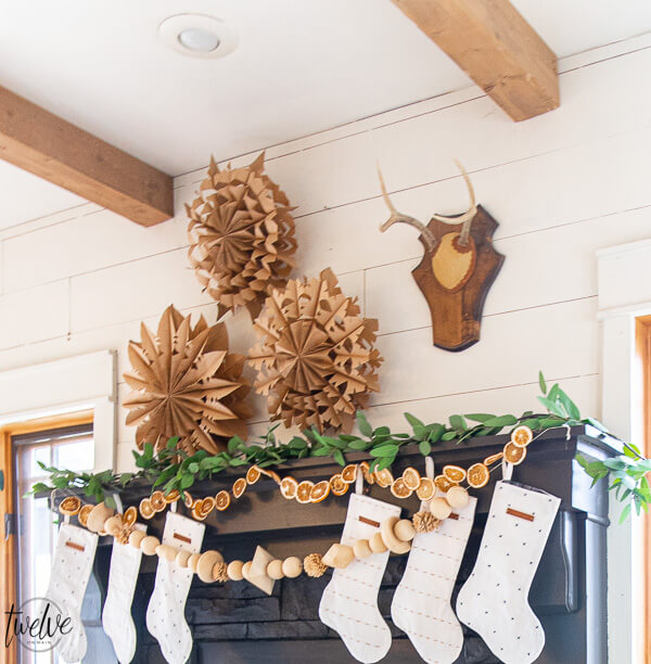 How to make gorgeous large or small paper bag snowflakes! These are so cool and make a big statement in your house. They are inexpensive too!