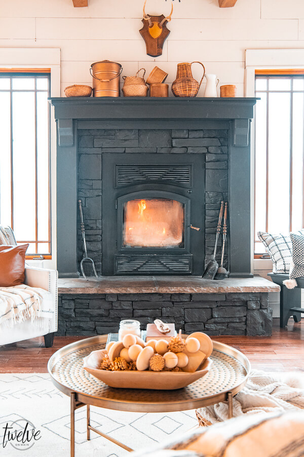 A collection of wooden and copper containers on the mantel inspired my winter decor.