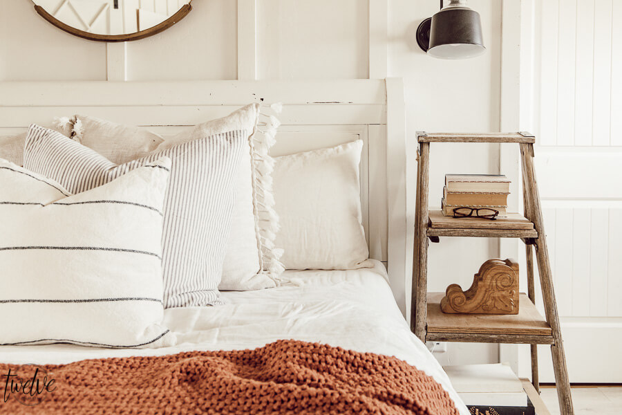 Cozy winter decor in the bedroom. Its easy to add accent colors and textures to give your space and warm and cozy feel that is perfect for winter.