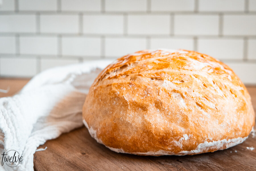 How to make easy no knead bread in the dutch oven or on a sheet pan! This takes 5 minutes to prepare and you can set it and forget it until you are ready to bake it!  Everyone will think you are a bread genius!  Click here!