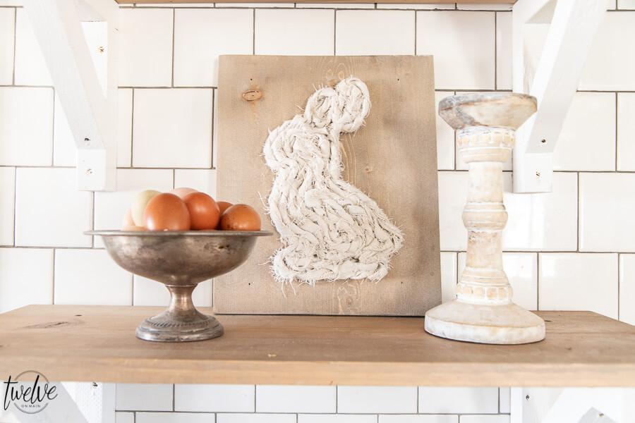 Scrap fabric bunny art using canvas drop cloth and a piece of scrap wood.