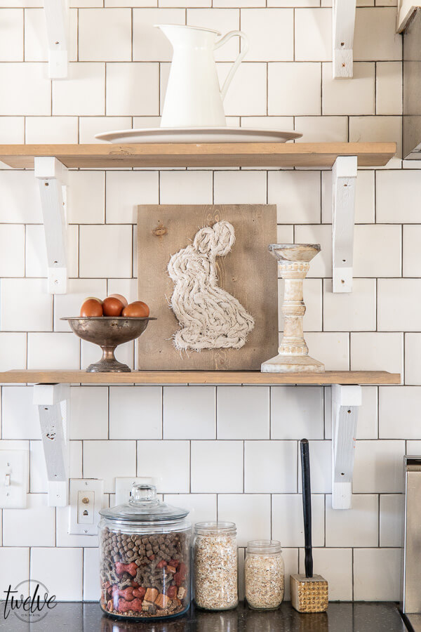Open shelves in the kitchen, styled for spring with simple bunny art using scrap wood and scrap fabric.