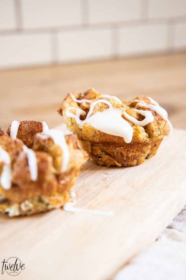 Brioche french toast muffins drizzled with cream cheese icing.