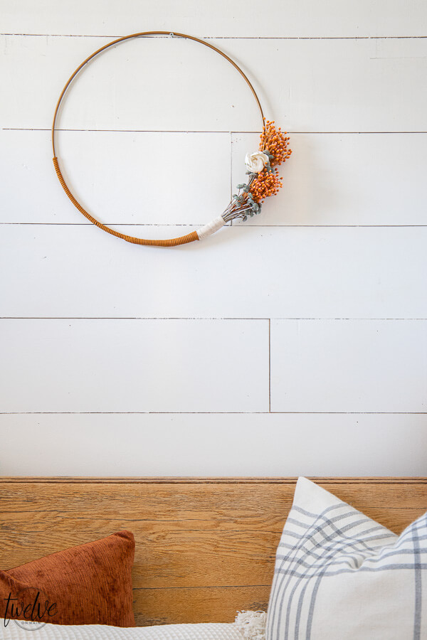 Gorgeous boho style hoop wreath for spring! This has beautiful dried flowers, twine and leather accents and will work in your home for more than just the spring season.