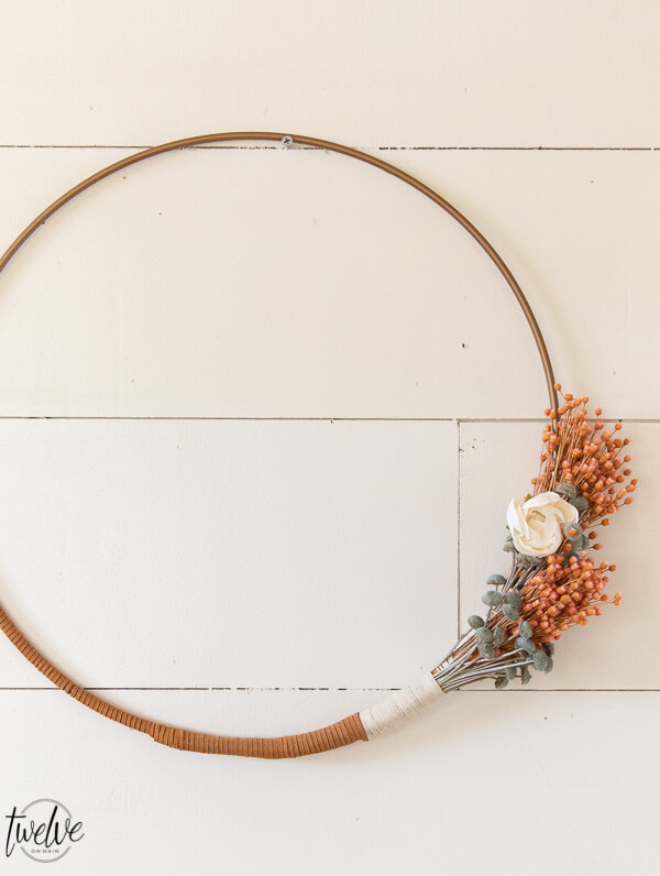 How to make a gorgeous boho style hoop wreath for spring. This is easy to make, affordable and you can customize to your style!