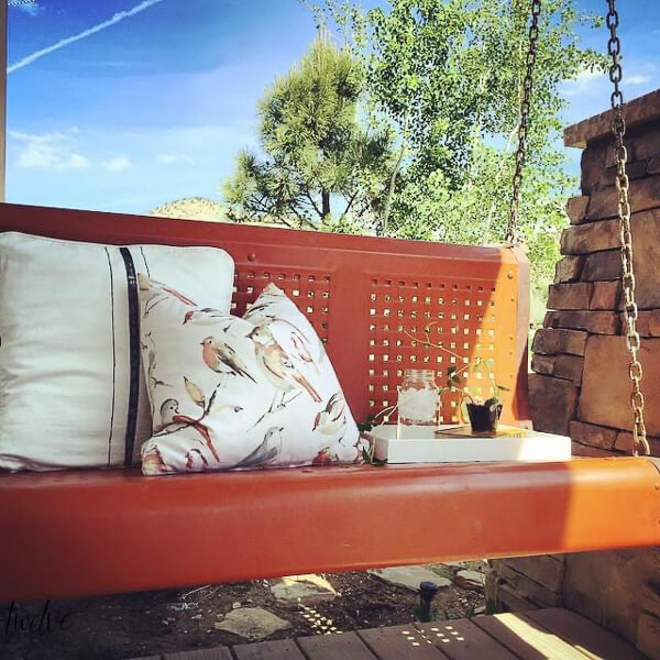 We up-cycled this old, rusted vintage metal glider into the perfect cozy porch swing perfect for relaxing on.