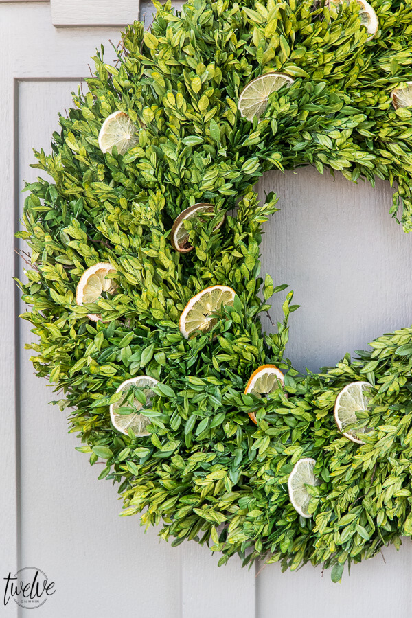 How to make a stylish boxwood and lemon summer wreath perfect for a front door or entry way.  It is easy to create and inexpensive!