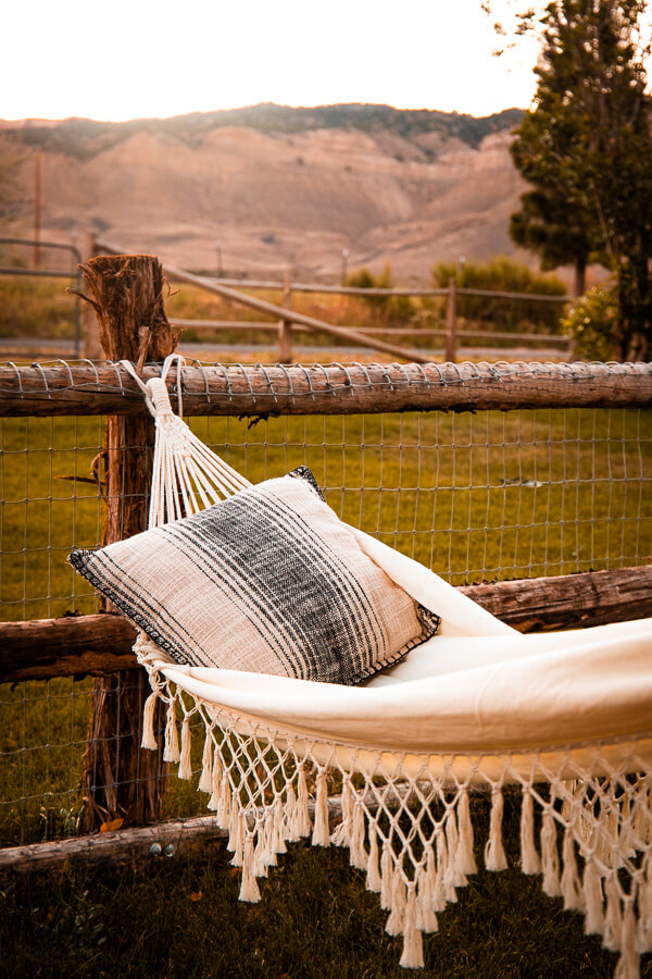 Gorgeous views with a macrame hammock and Bryce Canyon in the background.
