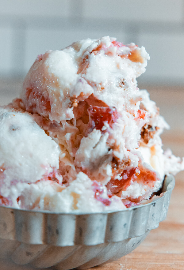 Make this amazing no churn strawberry cheesecake ice cream recipe right now! It is so easy to make and you do not need an ice cream machine.