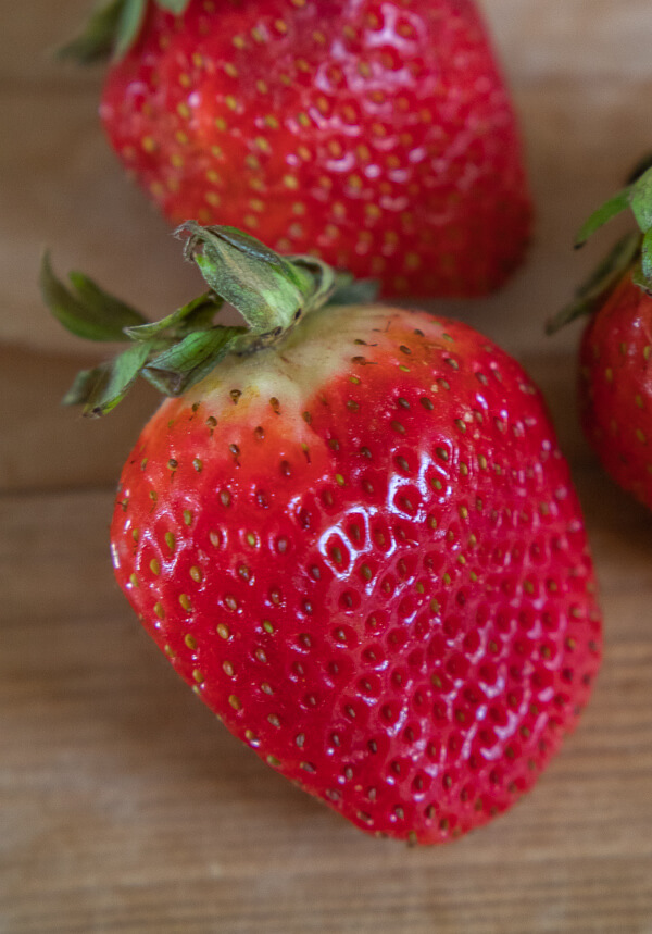 How to keep strawberries fresh for weeks!  These simple steps can change the way you keep these most delicate berries.  I have found mine to last up to three weeks instead of merely just a couple days.  Save money and get to enjoy all those strawberries you bought!