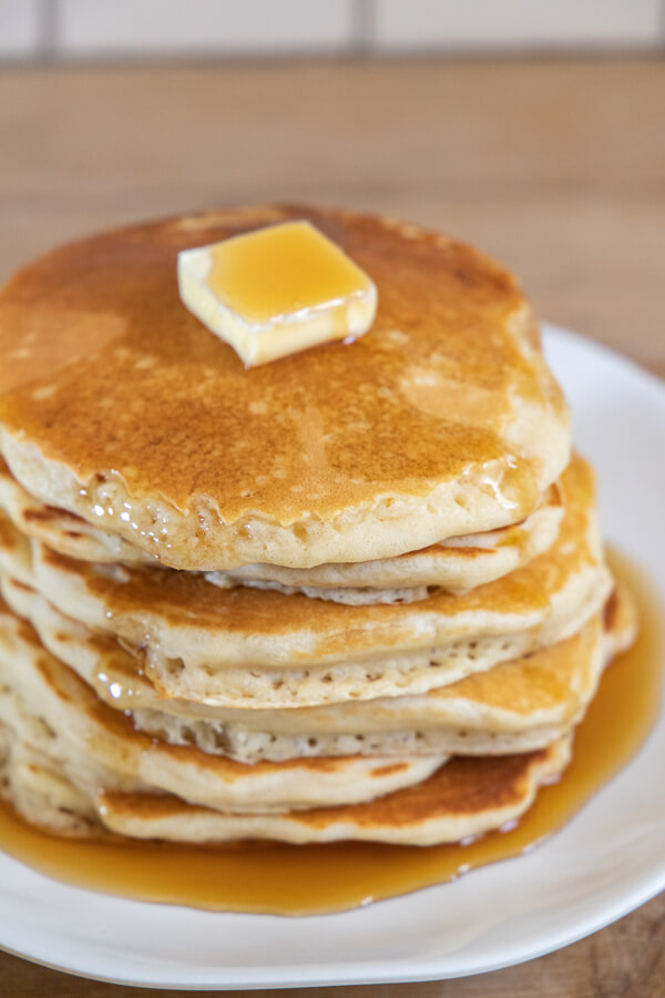 How to make amazing overnight sourdough pancakes that are good for you.  They have all those good benefits from long ferment sourdough because they get to sit overnight! When you wake up its as easy as stirring the batter up, and cooking up some amazing, flavorful, light and fluffy sourdough pancakes.