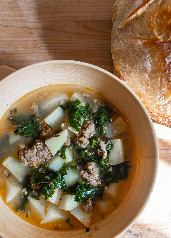 This potato, sausage and kale soup is hearty, flavorful and so easy to make!  Its the perfect weeknight meal or rainy day meal!