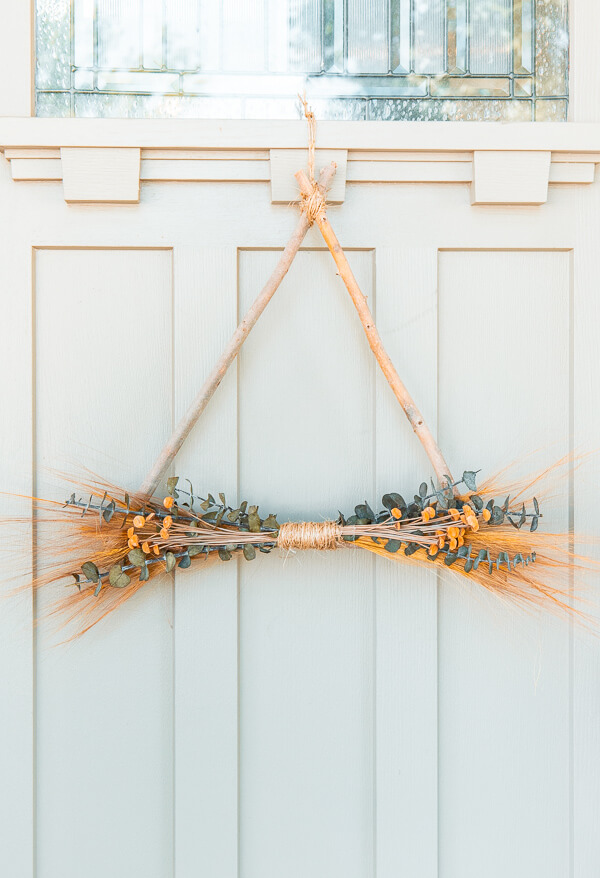 Make this easy and inexpensive nature inspired twig wreath perfect for fall! I have a step by step video tutorial as well!